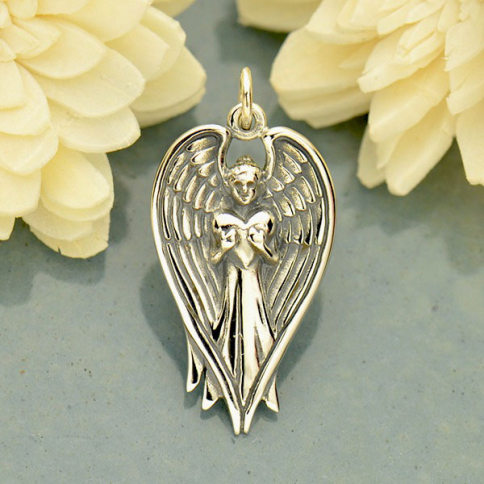 A1768   -SV-CHRM Sterling Silver Angel Pendant Holding Heart