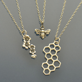 SET27   -SV-SETS Honey - Bee, Cherry Blossom and Honeycomb Charm Necklaces