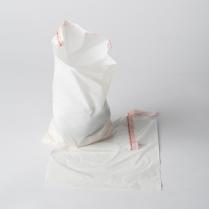 "PLASTIC BEDSIDE BAG, ADHESIVE STRIP, 7.5"" X 10.5"""