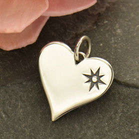 Sterling Silver Compass Symbol Heart Charm