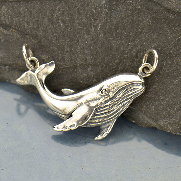 Antique silver finish whale charm on leather