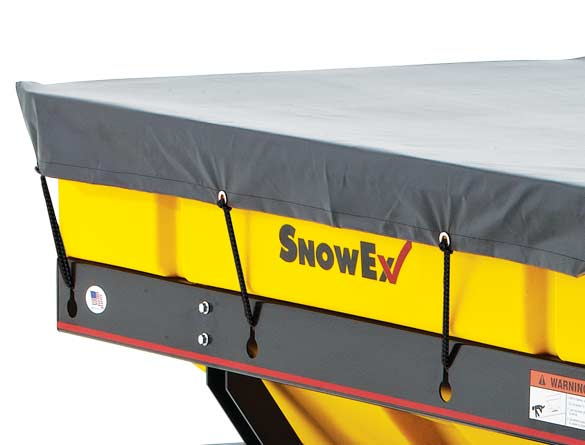 <strong><u>Fitted Tarp</u></strong><br/>A tarp fitted to the spreader's dimensions protects material from outside weather elements and keeps it dry.